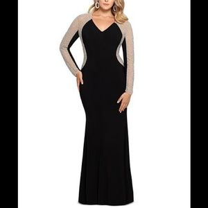 Black evening gown, with sheer rhinestone sleeves.